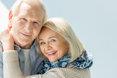 Portrait of smiling hugging senior couple Royalty Free Stock Images