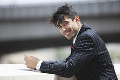 Portrait of smiling Indian businessman in pinstriped suit outdoors Royalty Free Stock Photo