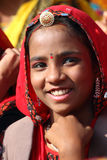 Portrait of smiling Indian girl at Pushkar camel fair Stock Image