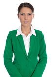 Portrait of a smiling isolated businesswoman wearing green blaze. Portrait of a successfu elegant isolated businesswoman wearing green blazer Royalty Free Stock Photos