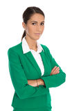 Portrait of a smiling isolated businesswoman wearing green blaze. Portrait of a successfu elegant isolated businesswoman wearing green blazer Royalty Free Stock Photo