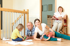 Portrait of smiling joyful multigeneration family in living room Royalty Free Stock Photos