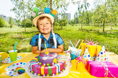 Portrait of smiling kid boy making a birthday wish Royalty Free Stock Images