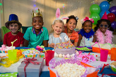 Portrait of smiling kids at table Royalty Free Stock Photos