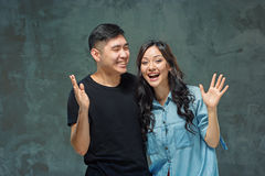 Korean lovers stock images download 738 photos portrait of smiling korean couple on a gray studio background royalty free stock image voltagebd Image collections