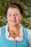 Portrait of a smiling lady in a dirndl Royalty Free Stock Image