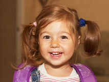 Portrait of a smiling liitle girl close-up Stock Image
