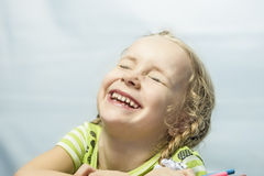 Portrait of a smiling little blond girl laughing Stock Images