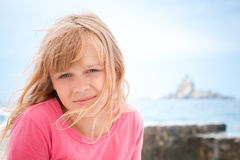 Portrait of smiling little blond girl in pink Royalty Free Stock Photos