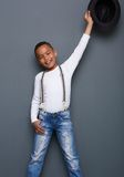 Portrait of a smiling little boy with arm raised Royalty Free Stock Photo
