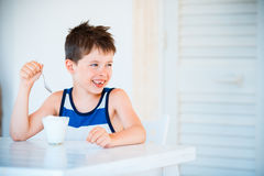 Portrait of smiling little boy refuses to eat delicious yogurt Royalty Free Stock Photos