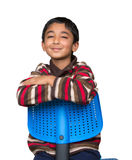 Portrait of a Smiling Little Boy Sitting on a Chair Stock Photos