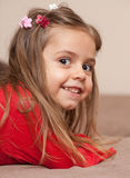 Portrait of smiling little girl. On sofa Royalty Free Stock Photo
