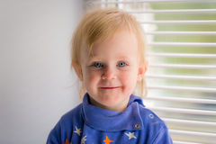 Portrait of a smiling little girl Stock Photos