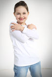 Portrait of smiling little girl. With crossed arms Royalty Free Stock Photos