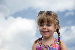 Portrait of a smiling little girl with braids Stock Photo