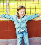 Portrait of smiling little girl child in the jeans clothes Stock Photo