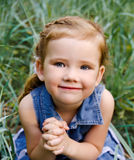 Portrait of smiling  little girl in dress outdoor Royalty Free Stock Photography