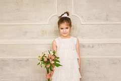 Portrait of a smiling little girl with flowers Royalty Free Stock Photo
