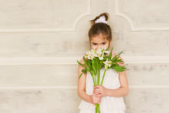 Portrait of a smiling little girl with flowers Stock Photography