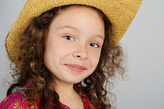 Portrait of smiling little girl in the hat Royalty Free Stock Images