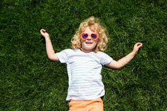 Portrait of a smiling little girl in heart shaped sunglasses Stock Photos