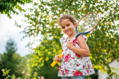 Portrait of a smiling little girl holding tennis Racket Royalty Free Stock Photo