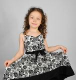 Portrait of smiling little girl in nice dress Royalty Free Stock Photo