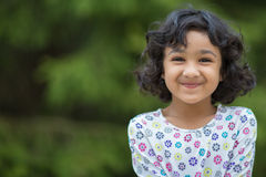 Portrait of a Smiling Little Girl. Outdoor Portrait of a Smiling Little Girl Stock Images