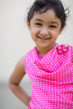 Portrait of a Smiling Little Girl. Outdoor Portrait of a Smiling Little Girl Royalty Free Stock Photography