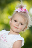 Portrait of a smiling little girl outdoors Royalty Free Stock Photo