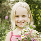 Portrait of smiling little girl outdoors Royalty Free Stock Photo