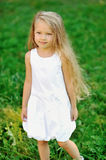 Portrait of a smiling little girl in a park Stock Photo