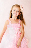 Portrait of smiling little girl in princess dress Stock Photo
