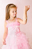 Portrait of smiling little girl in princess dress look at the br Royalty Free Stock Image