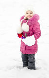 Portrait of smiling little girl with shovel in winter day Stock Photo