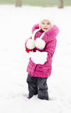 Portrait of smiling little girl with shovel in winter day Stock Photos