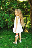 Portrait of a smiling little girl standing in a summer park Royalty Free Stock Image
