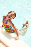 Portrait of smiling little girl swimming in pool. Portrait of little Caucasian girl in swimming pool looking at camera and smiling Royalty Free Stock Photography