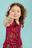 Portrait of smiling little girl with thumb up Stock Photo