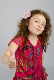 Portrait of smiling little girl with thumb up Royalty Free Stock Images