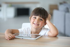 Portrait of smiling little girl using tablet Royalty Free Stock Images