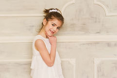 Portrait of a smiling little girl in white dress Royalty Free Stock Photography