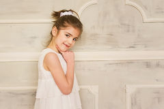 Portrait of a smiling little girl in white dress Stock Image
