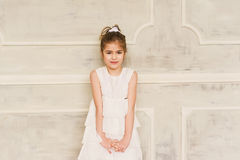 Portrait of a smiling little girl in white dress Stock Photography