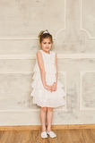 Portrait of a smiling little girl in white dress Royalty Free Stock Photos