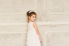 Portrait of a smiling little girl in white dress Royalty Free Stock Image