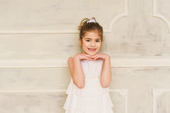 Portrait of a smiling little girl in white dress Stock Photo