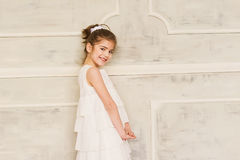 Portrait of a smiling little girl in white dress Royalty Free Stock Photo