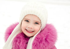 Portrait of smiling little girl in winter day Stock Photo